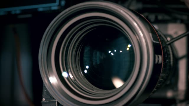 view of working camera lens - студийная фотография стоковые видео и кадры b-roll