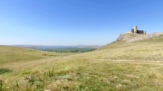 view of yeni sala fortress on the hill - męczennik filmów i materiałów b-roll