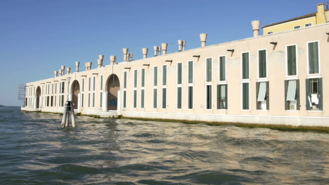 View on factory from water taxi in Venice, transportation, sightseeing video