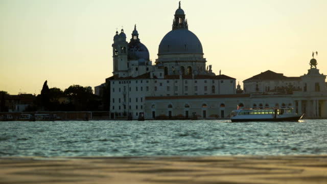 View on famous Santa Maria della Salute church and vaporetto sailing on canal video