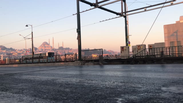 View on mosque and road with cars and buses sun in the frame Istanbul