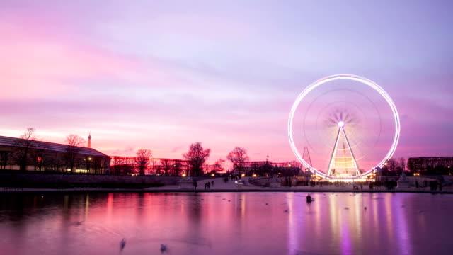 A View on Paris Ferris Wheel at Sunset