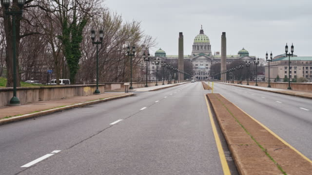 View on Pennsylvania State Capitol Complex from State Street. The city, which is usually busy during this time of weekday, is now deserted because of COVID-19 Novel Coronavirus Outbreak.