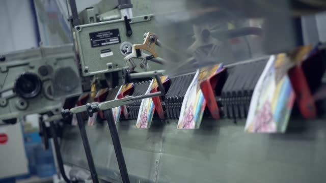 view on printing machine in action - postcard стоковые видео и кадры b-roll