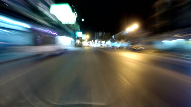 POV view on Riding motorbike along the Night Asian Road Traffic. Time lapse. Thailand, Pattaya