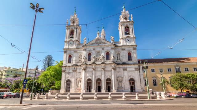vídeos de stock e filmes b-roll de view on the basilica da estrela from the streets of lisbon timelapse hyperlapse, portugal - lisbon