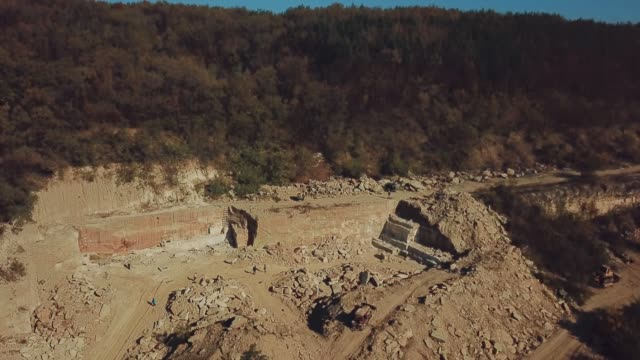 view on the sand quarry with the forest. - archeologia video stock e b–roll