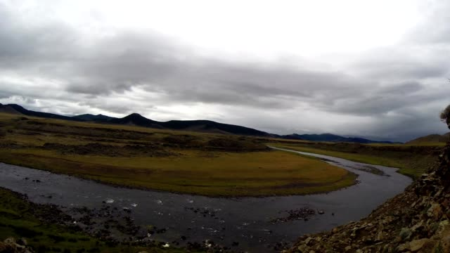 View on Unhurried Flow Mongolian Crystal Clear River in The Midst of a Vast Steppe From Rocky Hill video