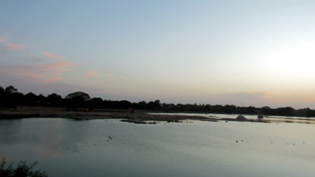 view or glance at the sunset from ancient lake. - occhiata laterale video stock e b–roll
