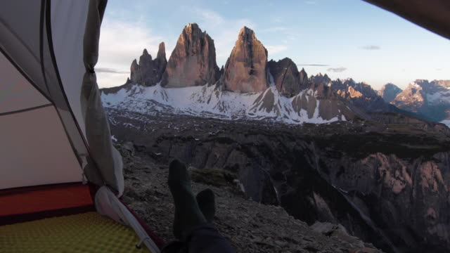 View out from tent as camper wakes up to amazing mountain view