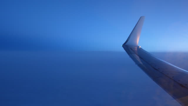 View out of plane window over dark blue sky video