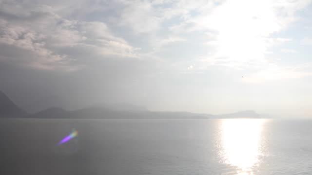 vídeos de stock e filmes b-roll de view out to lake and distant mountains - lago maggiore