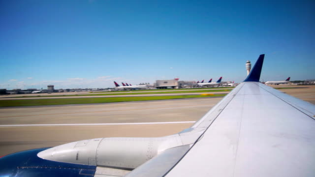 View over airplane wing during take off video