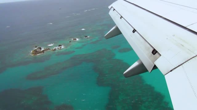 View over Bermuda Islands during aircraft landing. Beautiful turquoise water. Gorgeous nature landscape backgrounds.