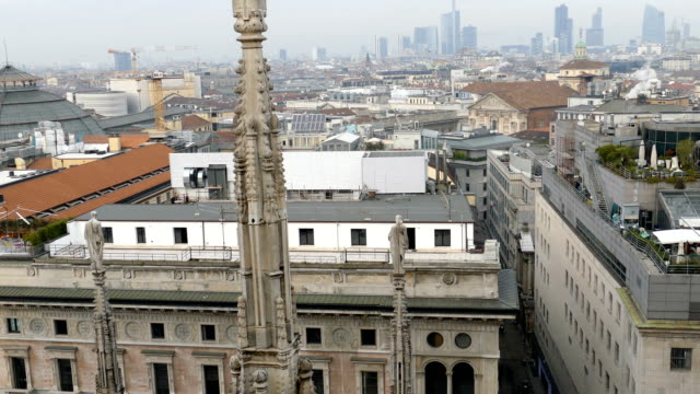 View over Milan and strret from the top of the gothic cathedral Duomo di Milano video