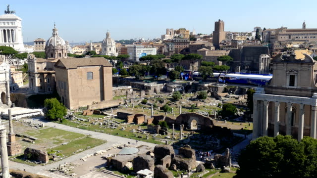 View over the ruins of the Roman Forum Rome, May 31, 2017: Panoramic view over the ruins of the Roman Forum with the cityscape. 4K footage. royalty stock videos & royalty-free footage
