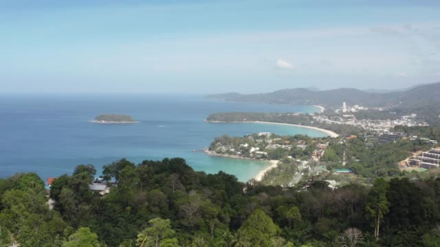 view point of karon beach, kata beach and kata noi in phuket, thailand. beautiful turquoise sea and blue sky from high view point. - phuket video stock e b–roll
