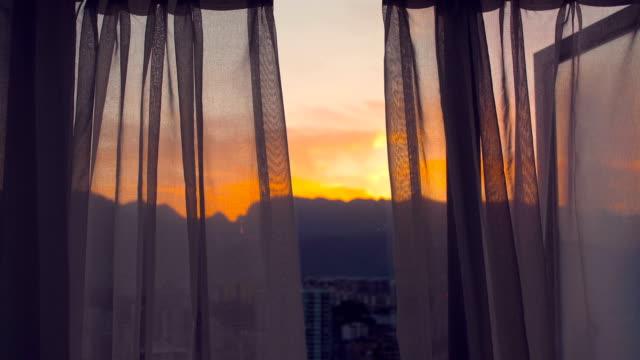 View the sunrise through curtains