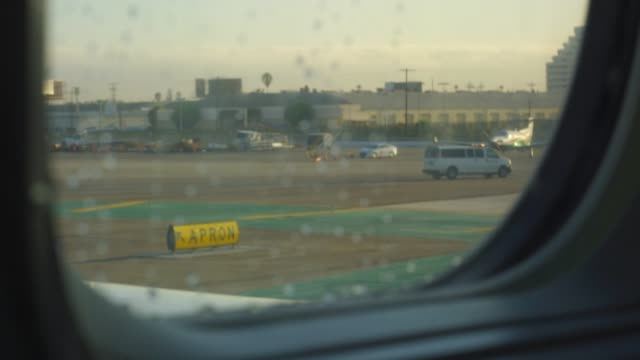 View through window from inside of moving airplane on runway video