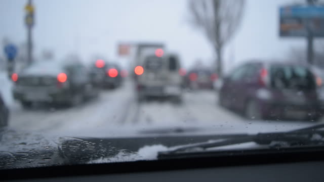 View through windshield on defocused scene on snowy city road video
