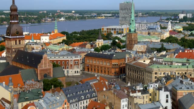 view to riga old town from tower of saint peters church. zoom out effect - латвия стоковые видео и кадры b-roll