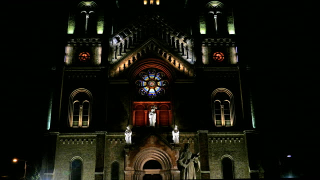 4K view with various night lighting of the Roman-Catholic Cathedral Millenium, Timisoara, Romania video