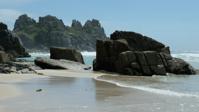 views across Pedn Vounder Beach towards Logan's Rock. video