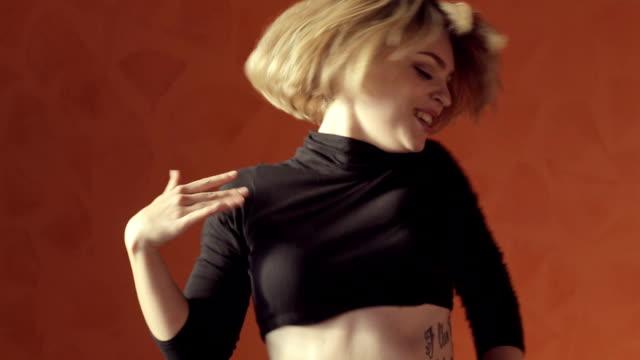 Vigorous blond woman dancing twerk video
