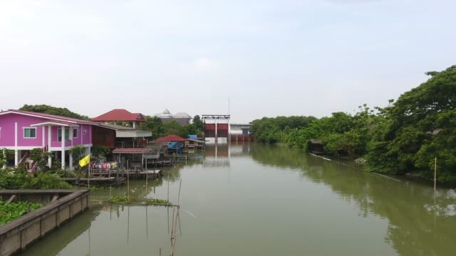 village, aerial view of thai house style along canal. - canale video stock e b–roll