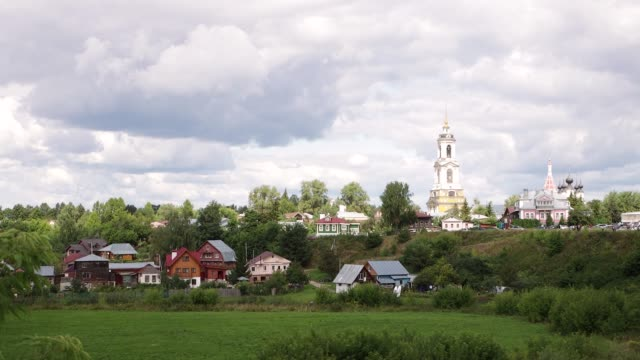 A village in dense green vegetation.