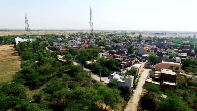 Village near pond elevated view Village near pond elevated view the shot is taken drone camera. haryana stock videos & royalty-free footage