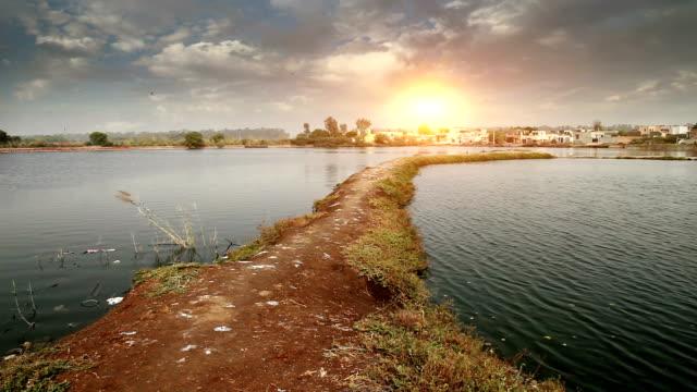 Village near pond Village near pond located on rural India. haryana stock videos & royalty-free footage