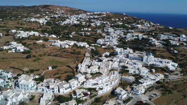 Village of Apollonia on the island of Sifnos in the Cyclades in Greece from the sky Sifnos est une île de Grèce des Cyclades, dans la mer Égée d'une superficie est de 70 km2. Elle compte environ 2 600 habitants. aegean sea stock videos & royalty-free footage