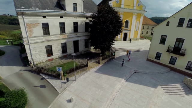 Village with big yellow church in the middle video