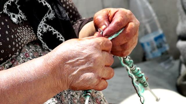 HD: Villager woman is knitting socks video
