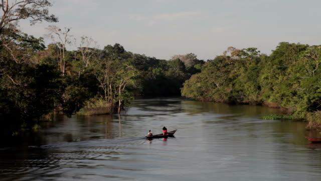 Villagers aboard river skiffs, Peruvian Amazon, Peru video
