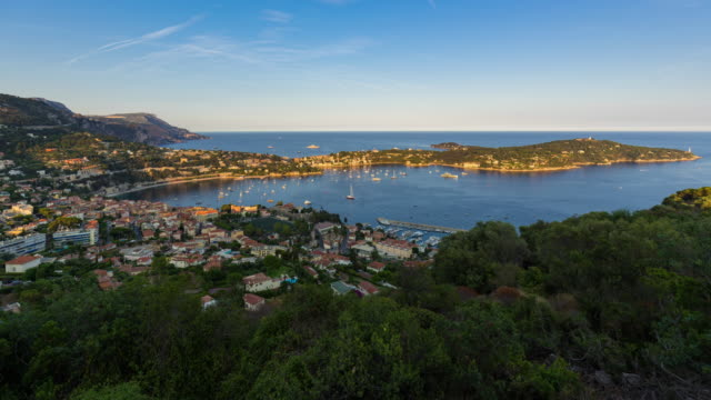 Villefranche-sur-Mer and Cap Ferrat in summer (sunset to twilight time-lapse). Cote d'Azur, French Riviera, France - vídeo