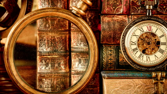 Vintage antique pocket watch against the background of old books video