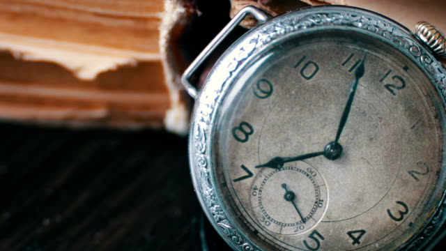 Vintage Antique pocket watch on the background of old books. video