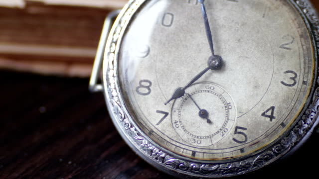 Vintage Antique pocket watch on the background of old books video
