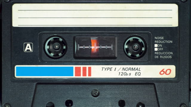 vintage audio cassette begins to play in the tape deck