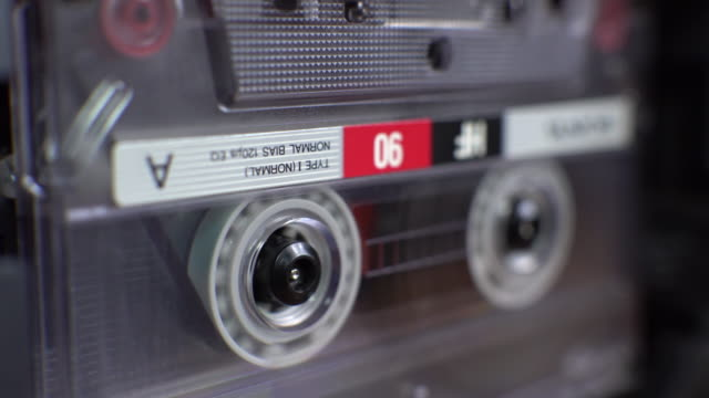 vintage audio cassette begins to play in the tape deck video