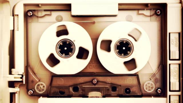 vidéos et rushes de cassette compacte de bande audio vintage - image teintée