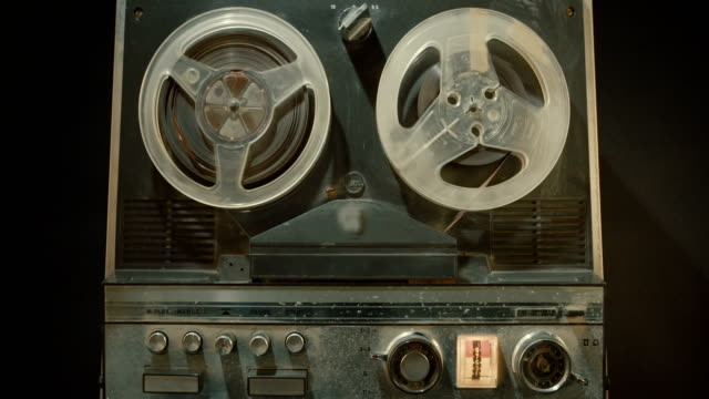 Vintage audio tape to tape recorder Vintage audio tape to tape recorder sound recording equipment stock videos & royalty-free footage