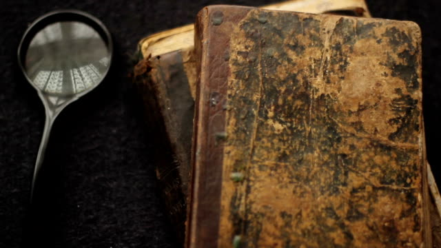 Vintage Books, Bible and Magnifying Glass
