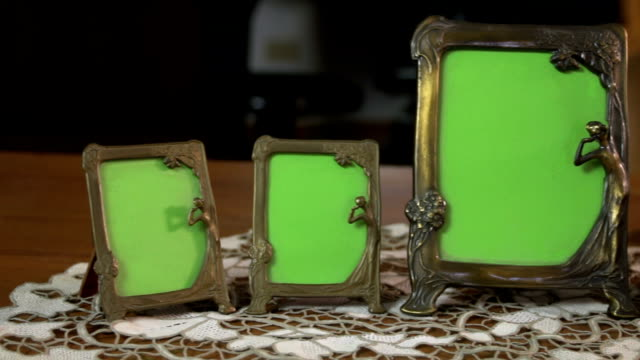 Vintage bronze picture frames with an ancient ink well FDV
