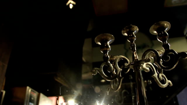 Vintage chandelier on reserved table, glass full of champagne video