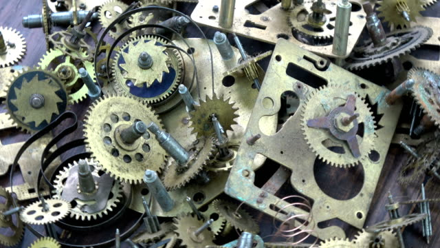 Vintage clock brass gears and cogs rotating background video