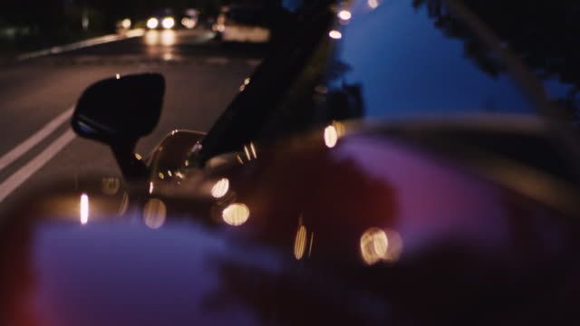 Vintage, elegant sport car ride after dusk. Shiny lacquered metal sheet Luxurious car details. Close up on shiny, chrome sheet luxury car stock videos & royalty-free footage