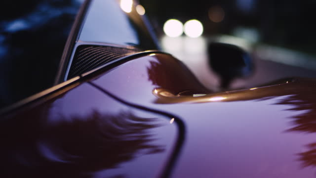 Vintage, elegant sport car. Shiny lacquered metal sheet Luxurious car details. Close up on shiny, chrome sheet luxury car stock videos & royalty-free footage